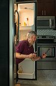 Funny dirty appliance repair homeowner man in refrigerator