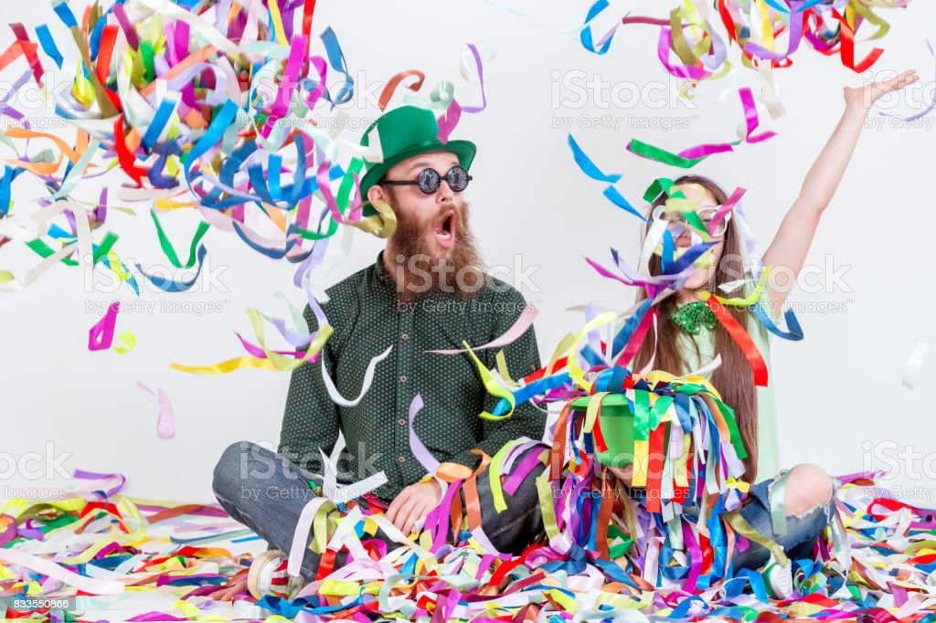 Funny Duet Of Cheersful People Playing With Ribbons stock photo