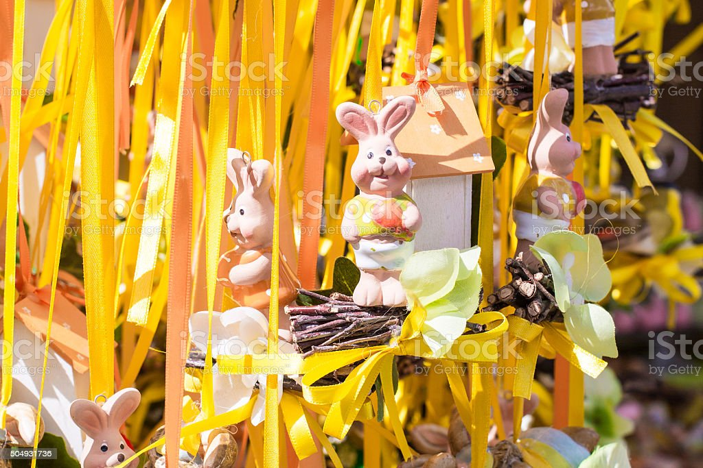 Funny Easter rabbits figurines in a market stock photo