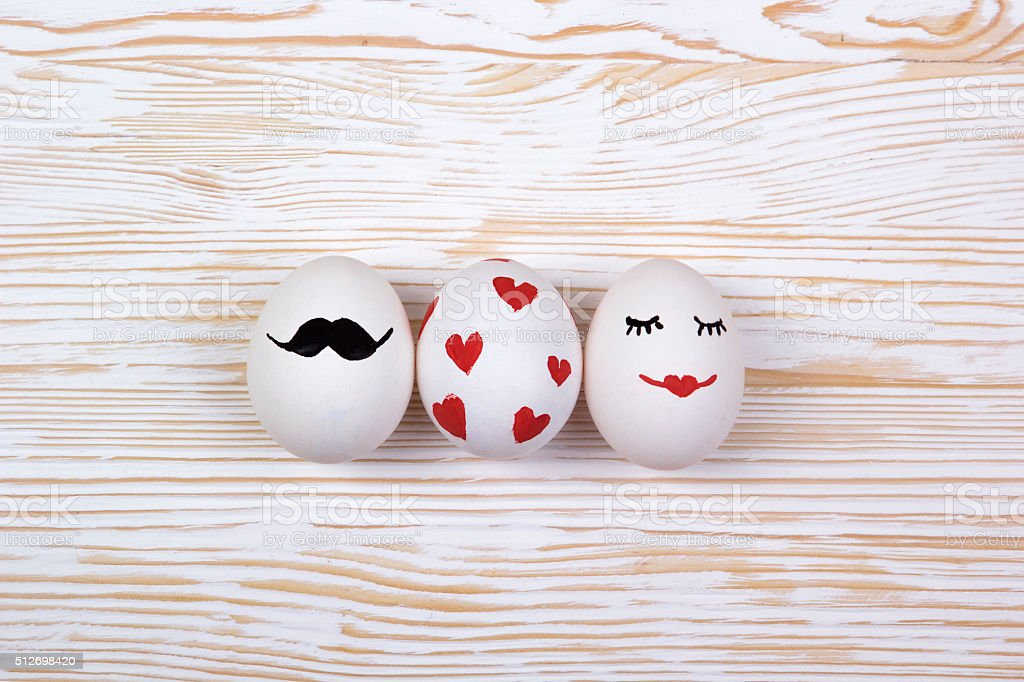 Funny eggs with painted faces stock photo