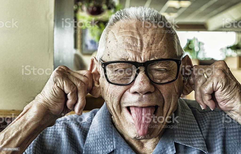 Funny Elderly Man Goofy Mug Shot stock photo