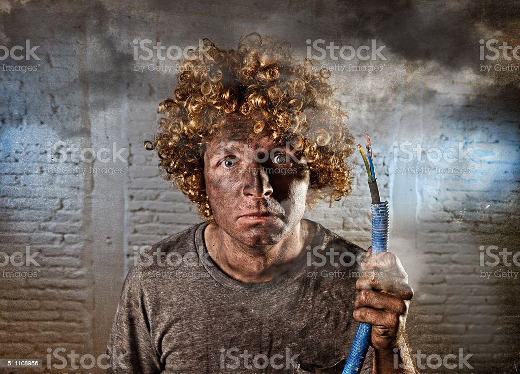 funny electrocuted man suffering domestic accident dirty burnt face shock stock photo