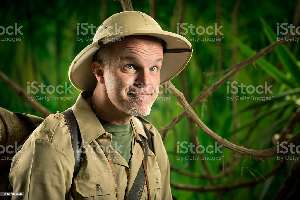 Funny explorer in the forest stock photo