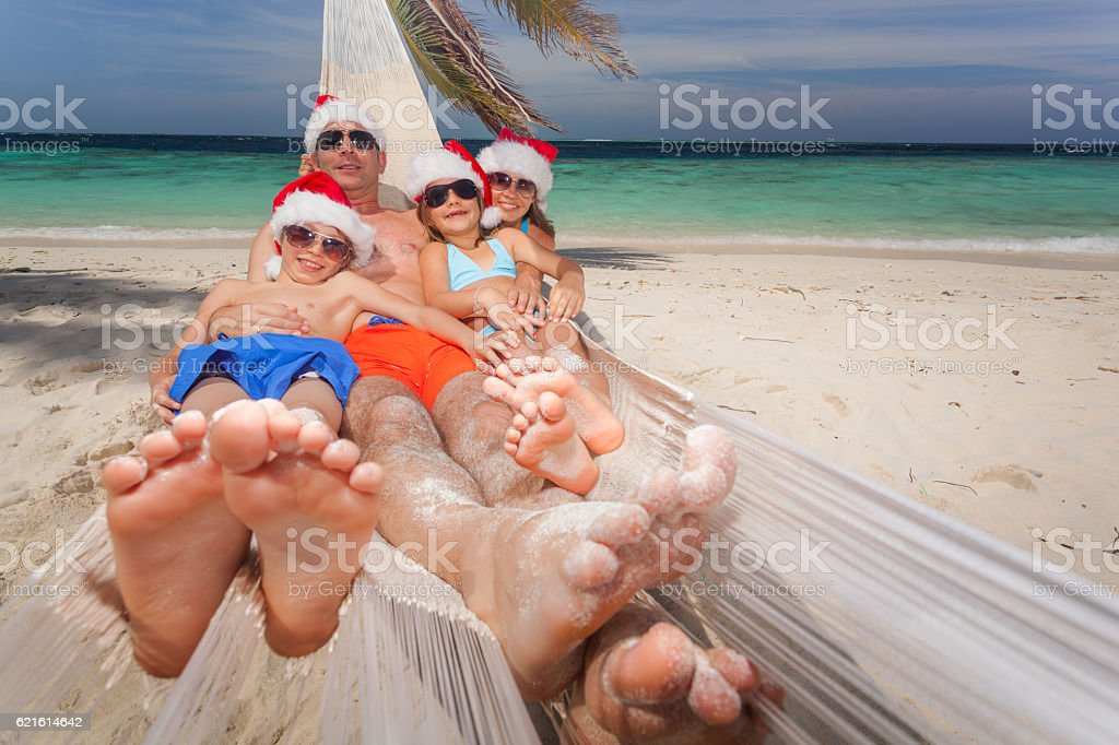 funny family merry christmas tropical island stock photo