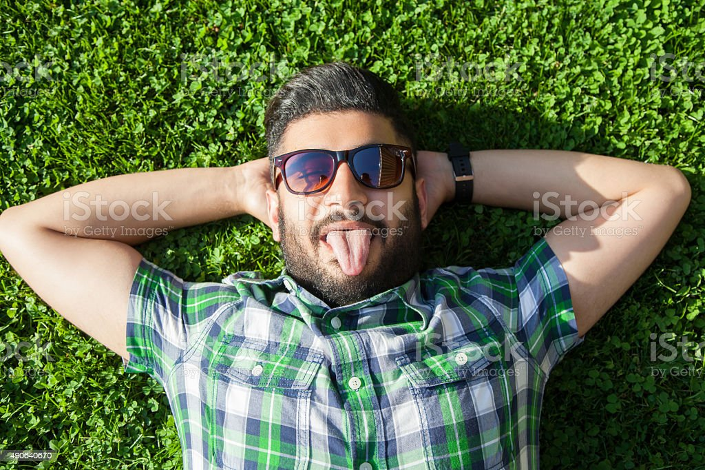 funny fashion middle eastern man show his tongue. stock photo