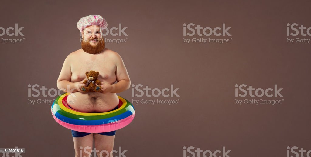 Funny fat bearded man in a swimsuit. stock photo
