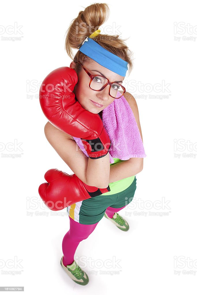 Funny female boxer posing with her red boxing gloves stock photo