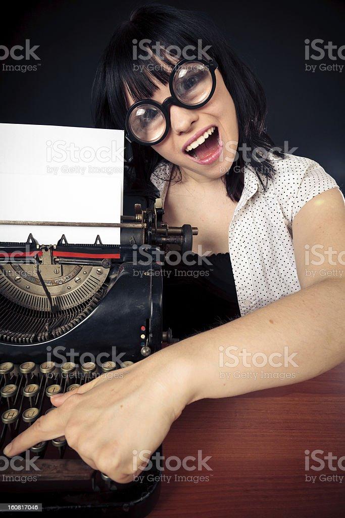 funny female nerd with typewriter royalty-free stock photo