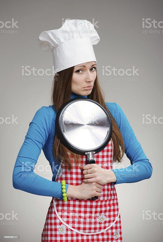 Funny female portrait - klutz in the kitchen stock photo