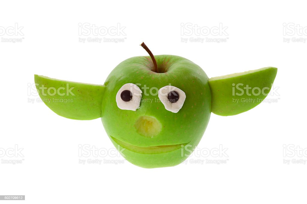 Funny figure carved out of an apple - isolated stock photo