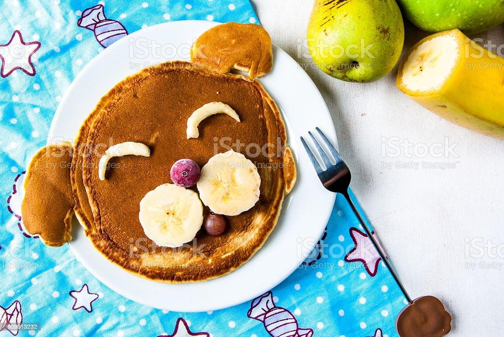 Funny food for children, breakfast pancakes stock photo