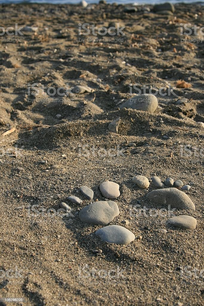 Funny footprints on the shore stock photo