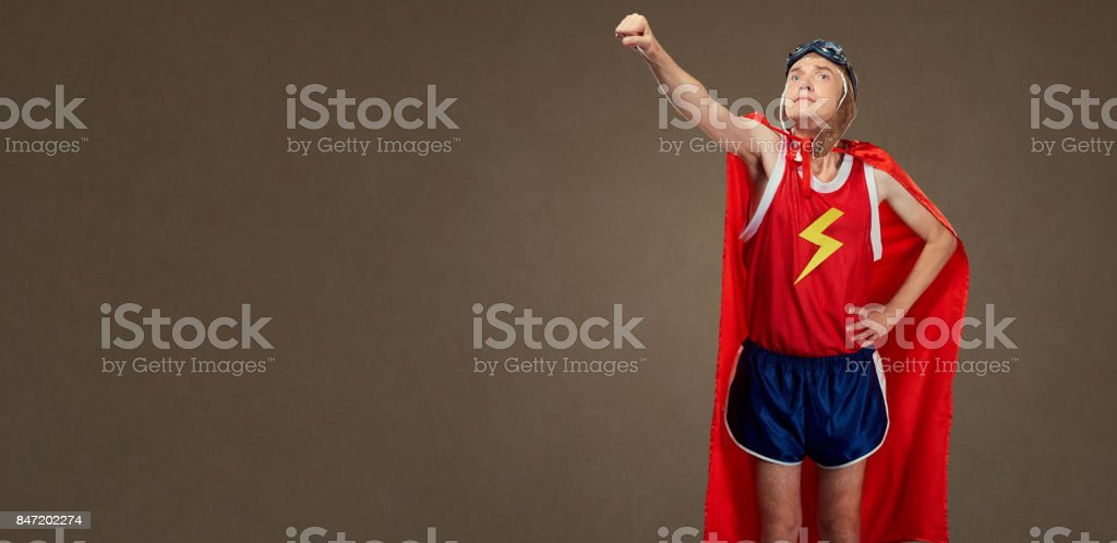 Funny funny cheerful man in a superhero costume in sports clothe stock photo