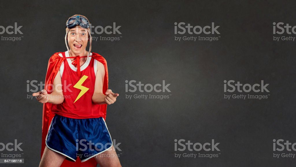 Funny funny cheerful man in a superhero costume. stock photo