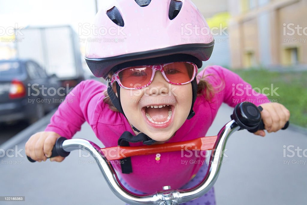 funny girl and bicycle stock photo