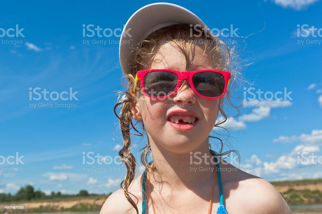 Funny girl at the beach stock photo