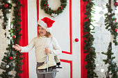 funny girl child in santa hat  porch of house, lifestyle,