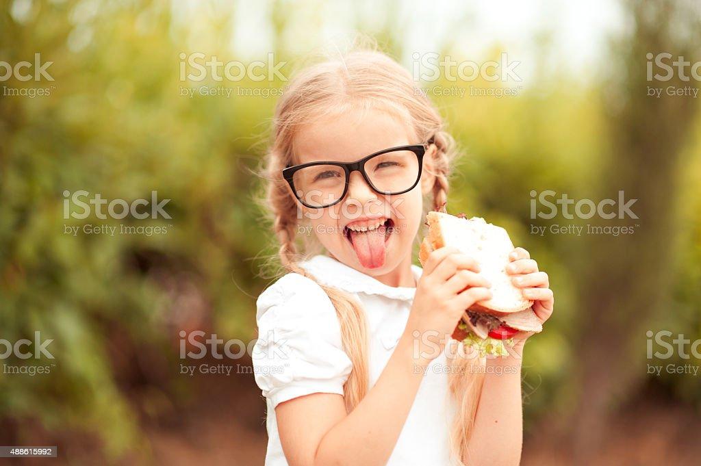 Funny girl eating stock photo