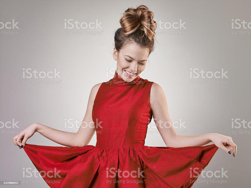 Funny girl makes curtsy stock photo