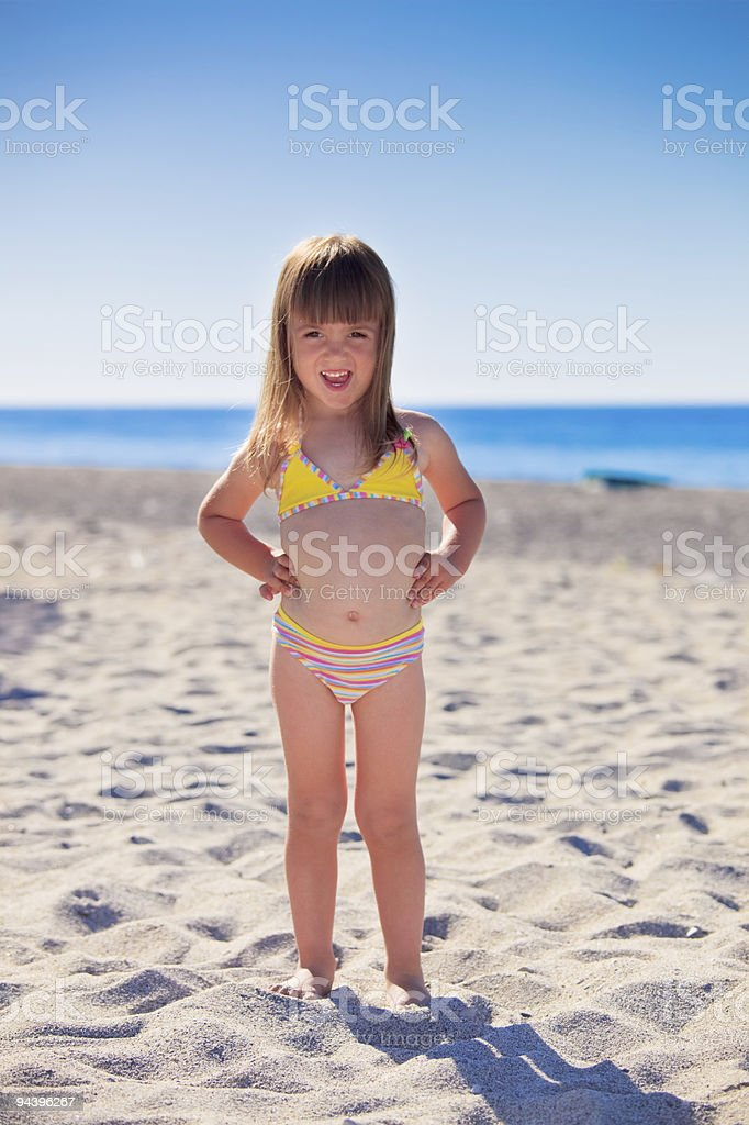 Funny girl on a beach royalty-free stock photo