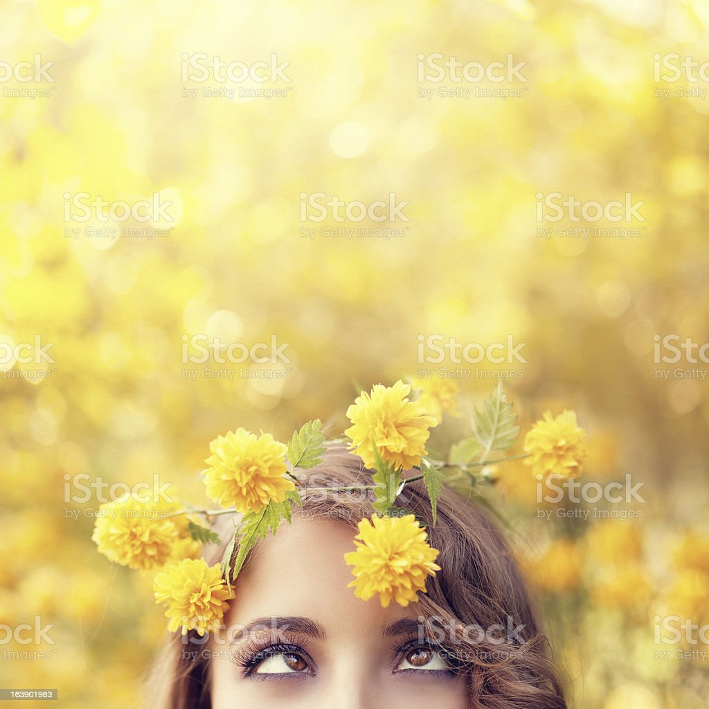 funny girl wearing yellow flower wreath royalty-free stock photo