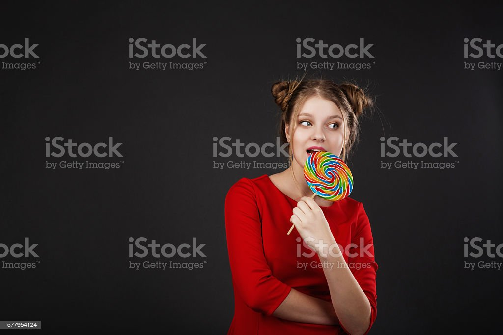 Funny girl with a lollipop stock photo