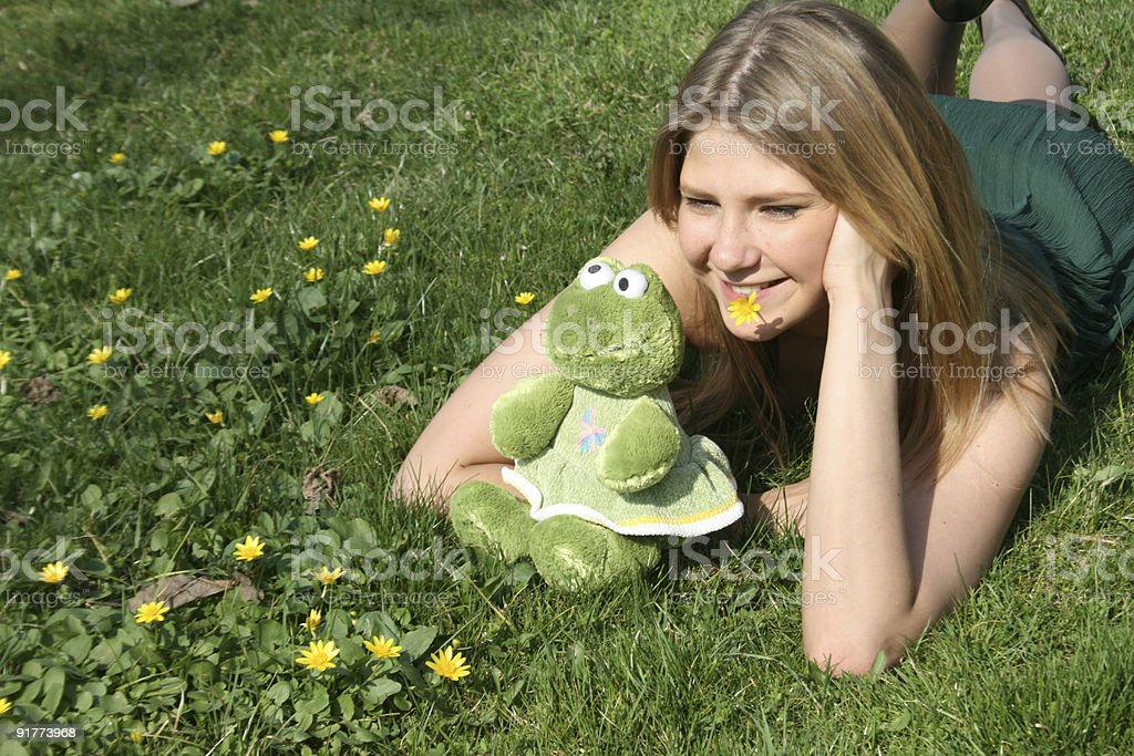 Funny girl with a toy frog royalty-free stock photo