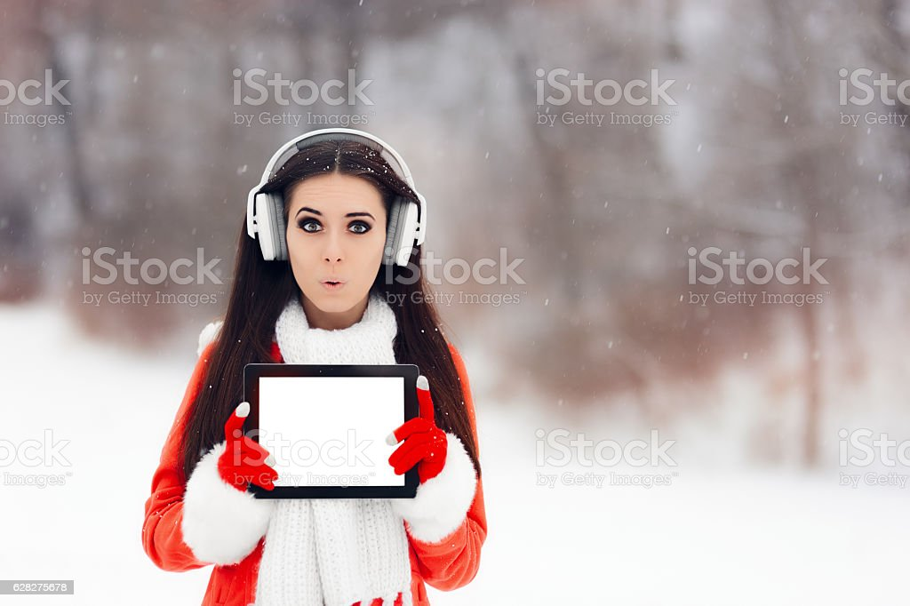 Funny Girl with Headphones Holding Tablet Pc stock photo