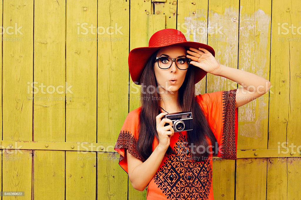 Funny Girl with Retro Photo Camera and Red Sun Hat stock photo