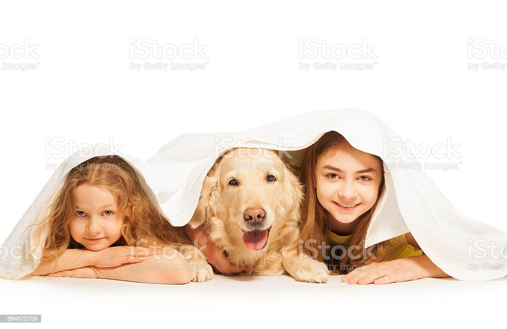 Funny girls and their pet covered with white towel stock photo