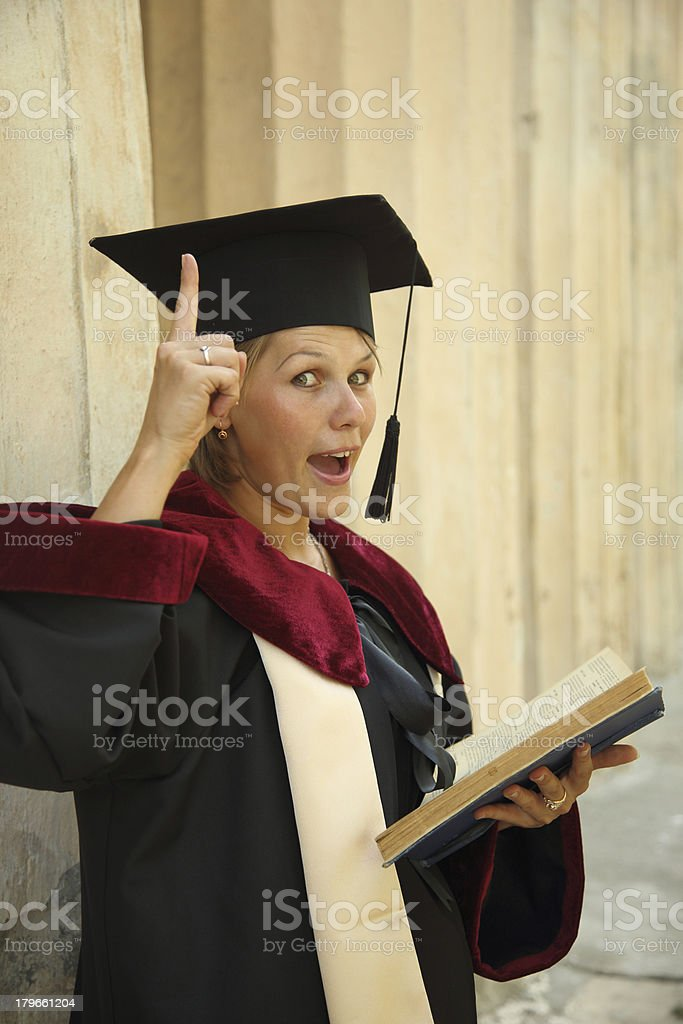 funny graduate with a book royalty-free stock photo