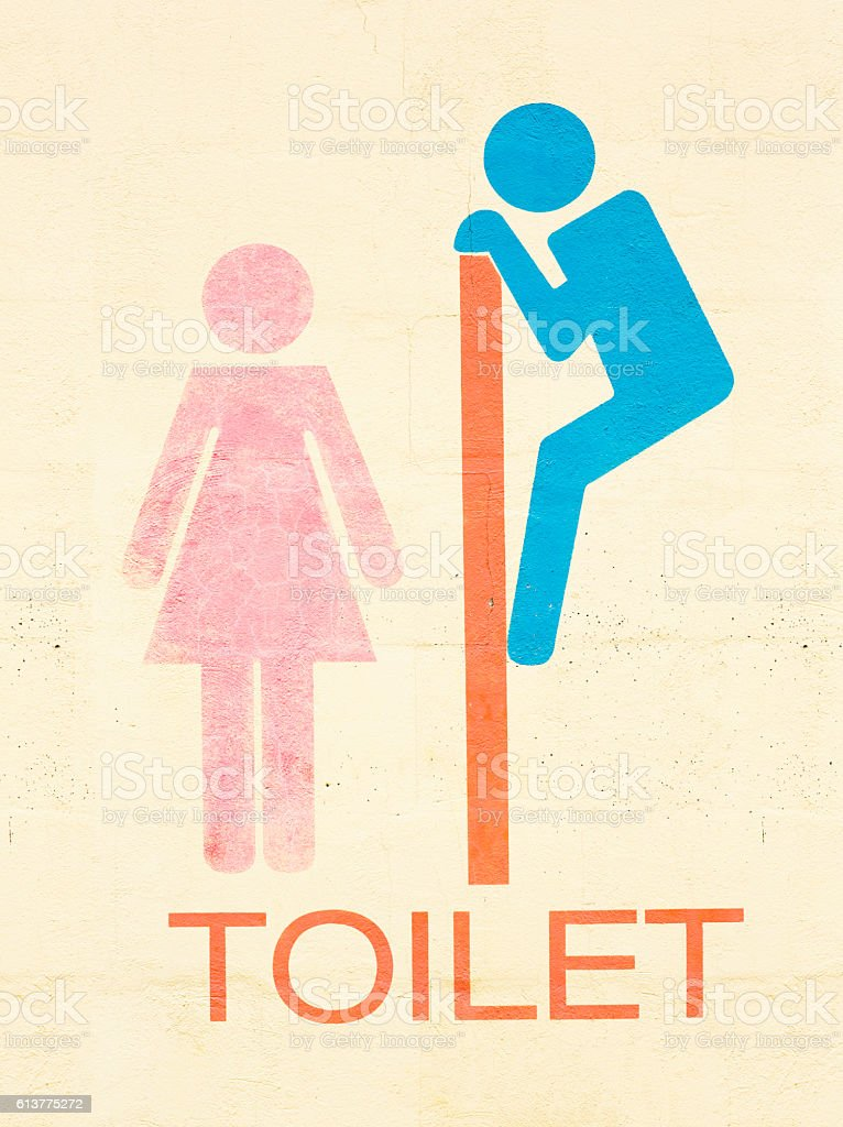 Funny graffiti painting on wall of a toliet stock photo