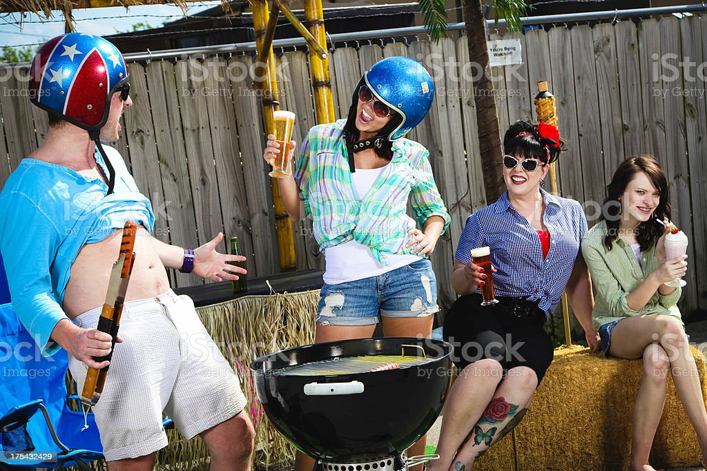 Funny Group Grill Out- Woman Looking at Man's Belly royalty-free stock photo
