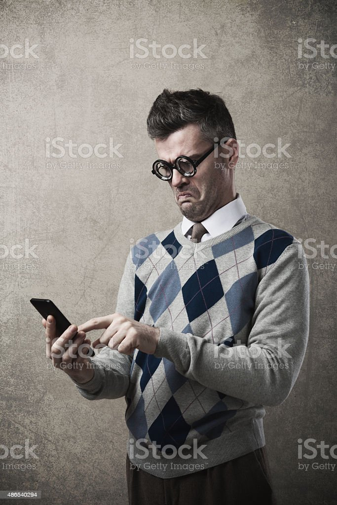 Funny guy having troubles with his smartphone stock photo