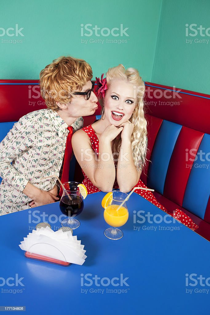 Funny guy kissing a girlfriend royalty-free stock photo