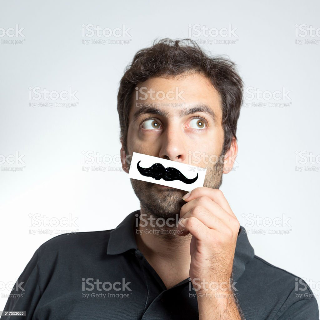 funny guy with fake moustache stock photo