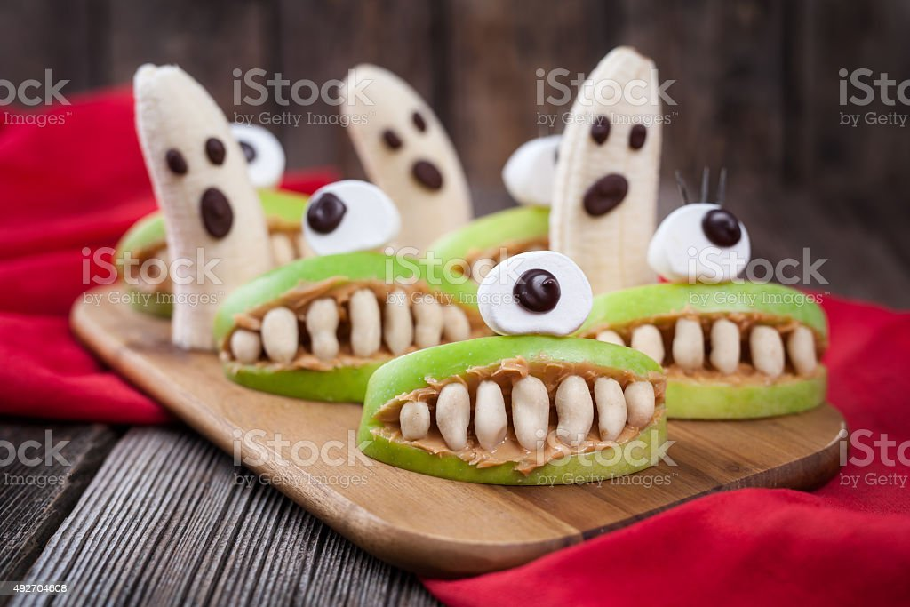 Funny halloween eadible monsters scary food healthy vegetarian snack dessert stock photo