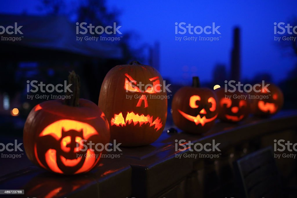 Funny halloween pumpkins at night stock photo