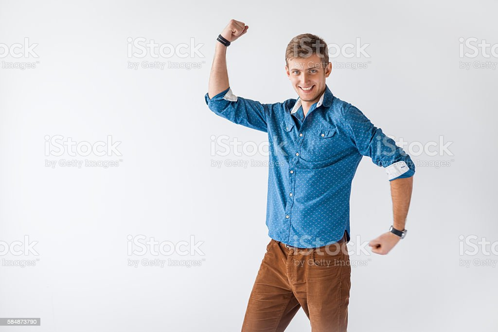 Funny handsome man showing his biceps stock photo