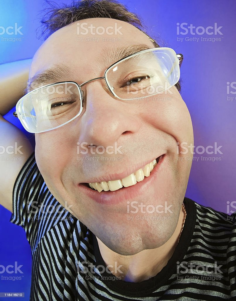 Funny happy man in glasses portrait on vivid color background royalty-free stock photo