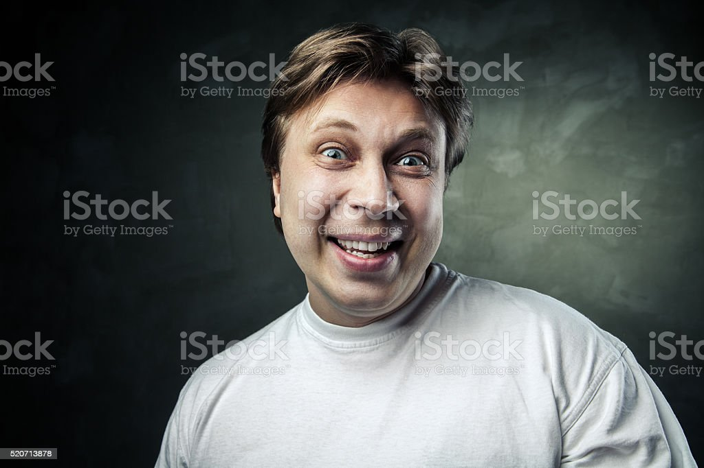funny holarious middle aged man over gray stock photo
