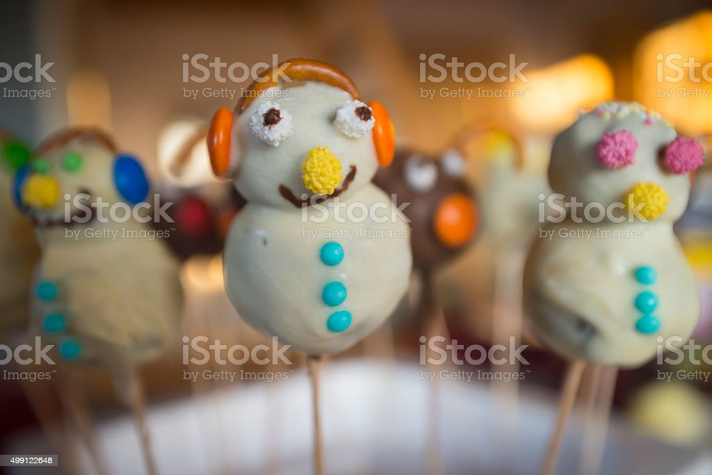 Funny homemade cake pops in the form of snowmen stock photo