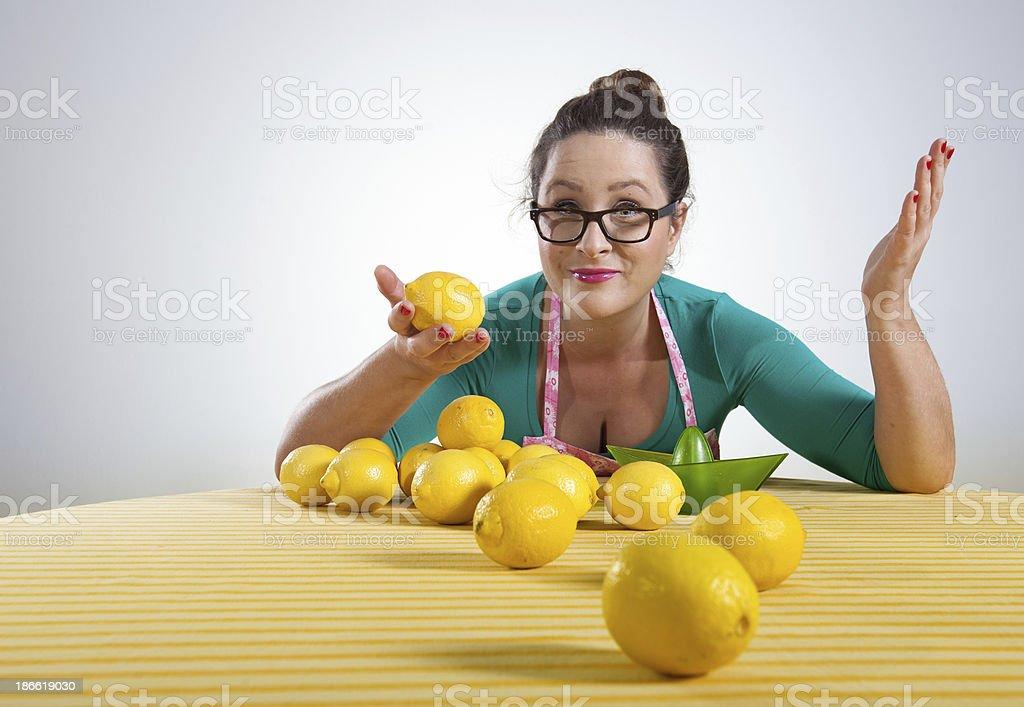 Funny housewife making lemonade royalty-free stock photo