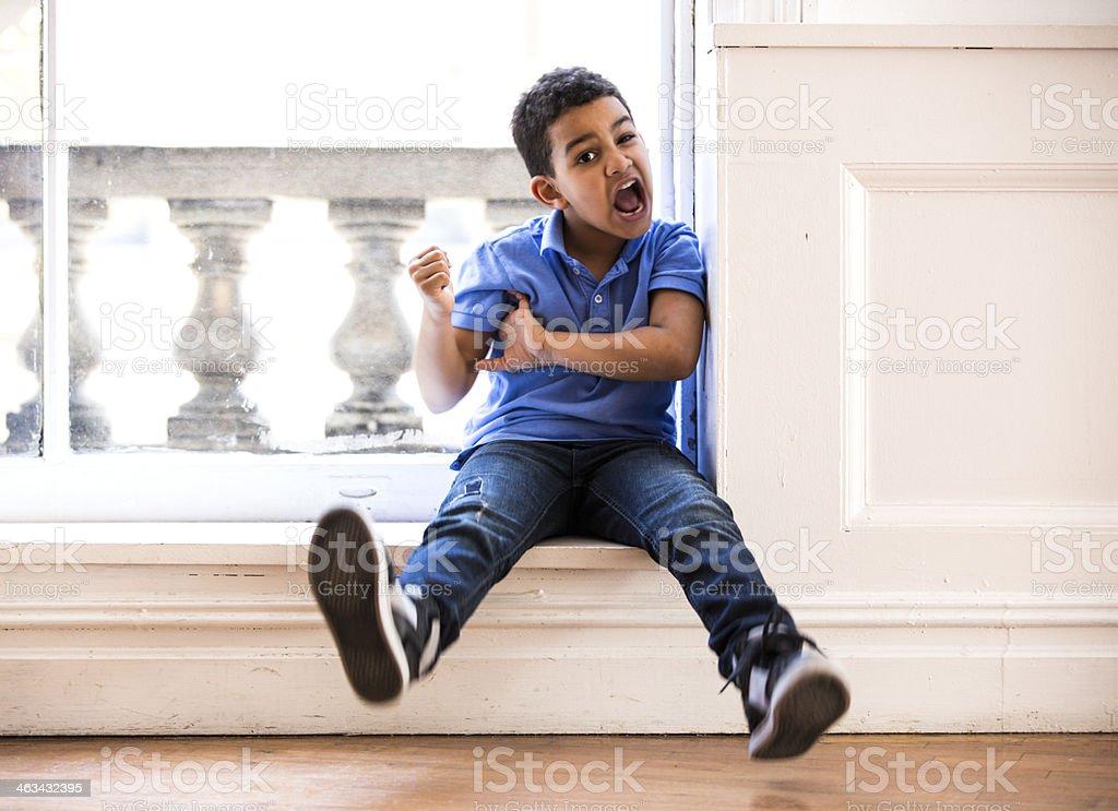 Funny Kid Clowning Around stock photo