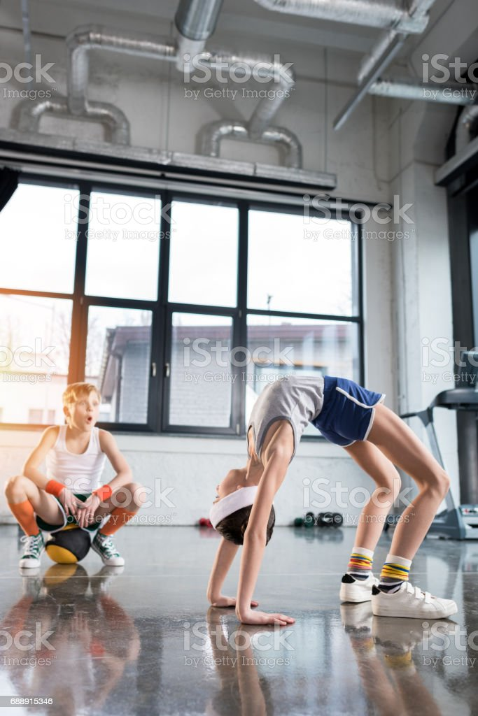 funny kids in sportswear training at fitness studio together, children sport concept stock photo