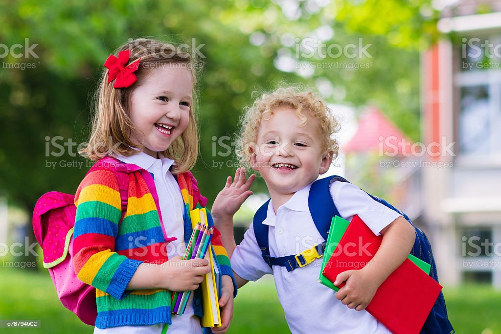 Funny kids on first school day stock photo