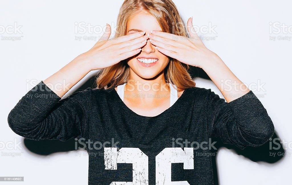 Funny lifestyle portrait beautiful blond crazy girl closes eyes stock photo