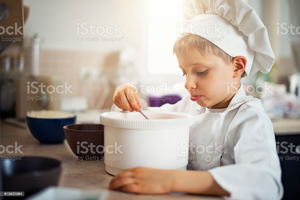 Funny little chef cooking stock photo