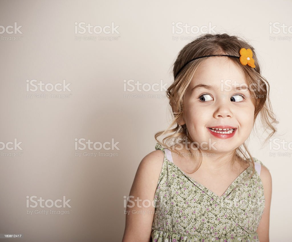Funny Little Girl Making a Silly Face royalty-free stock photo