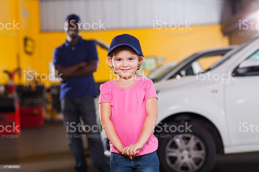 funny little girl wearing auto technician's cap royalty-free stock photo